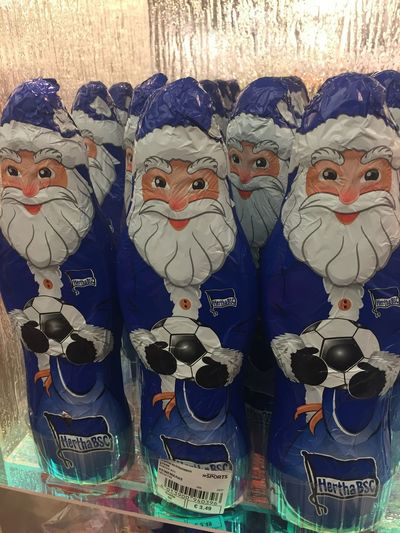 Santa Claus chocolate figures with Hertha Berlin symbol Close-up Representation Chocolate Chocolate♡ Figurine  Figurines  Christmas Christmas Chocolate Christmas Figures Hertha BSC Choice In A Row Retail  Creativity For Sale Market Groceries