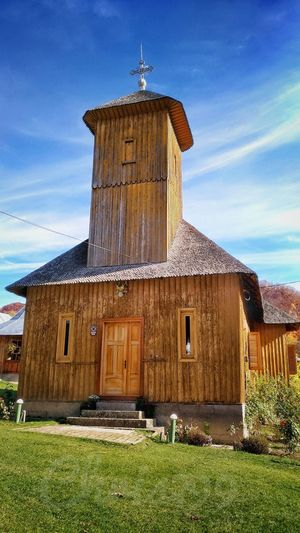 Lepsa Monastery, Old One, Vrancea Romania. Building Exterior Built Structure Grass Sky House Outdoors History Roof Day No People Monument Romania Green Color Landmark Monastery Architecture Cloud - Sky Lepsa Wooden Structure Blue Sky And Clouds Wood Model Old Architecture Old Monastery Religious Buildings Worship Places
