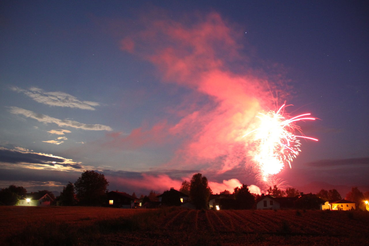 night, sky, illuminated, motion, cloud - sky, nature, no people, field, environment, burning, glowing, celebration, exploding, land, firework, event, outdoors, fire, heat - temperature, smoke - physical structure, firework display