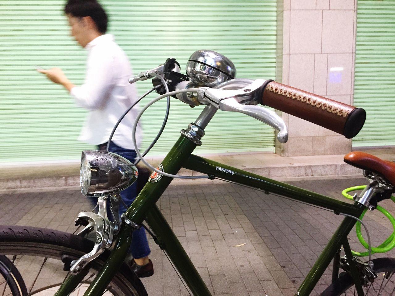 Bicycle against man walking on footpath