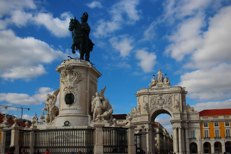 Lisbon - Portugal Lissabon, Portugal Lisbon Praça De Comércio Sculpture Art And Craft Representation Statue Human Representation Sky Architecture Cloud - Sky Creativity History Low Angle View The Past Travel Destinations Travel No People Arch Outdoors City Gate