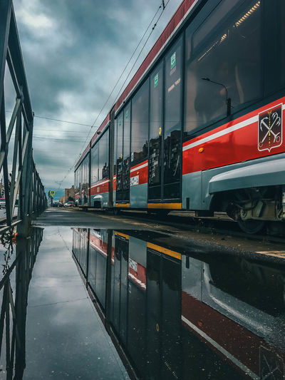 Train in city against sky