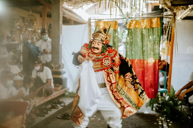 Man wearing costume dancing outdoors