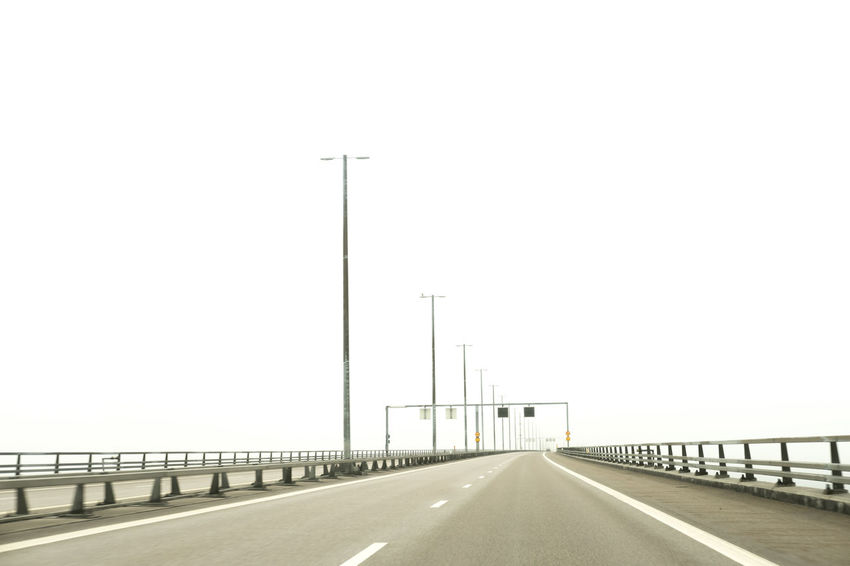 Architecture Asphalt Built Structure Clear Sky Connection Copy Space Desert Diminishing Perspective Empty Empty Road Fog Long NOthIng Nowhere Outdoors Railing Road Road Marking Sky Street The Way Forward Transportation Vanishing Point