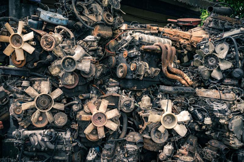 Stack Of Abandoned Engines At Junkyard