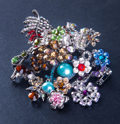 High angle view of diamond brooch on textured table