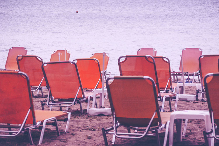 Empty chairs at beach