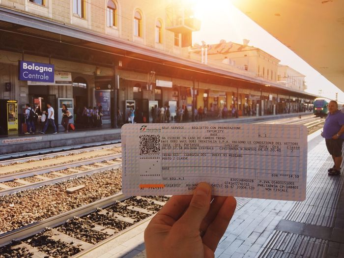 Ticket to summer vacation 🚂... Summer Adventure ShotOnIphone Traveling Travel Destinations Business Paper Holding Trainstation Train Station Ticket Travel Real People Human Hand Human Body Part Men Railroad Track Public Transportation Transportation Train - Vehicle Rail Transportation Architecture Built Structure Lifestyles Building Exterior City Close-up Outdoors
