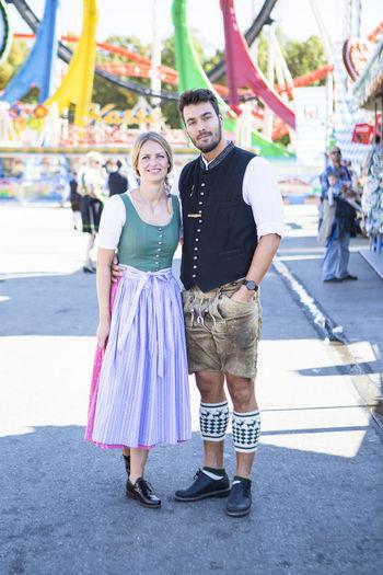 Portrait of couple standing at amusement park