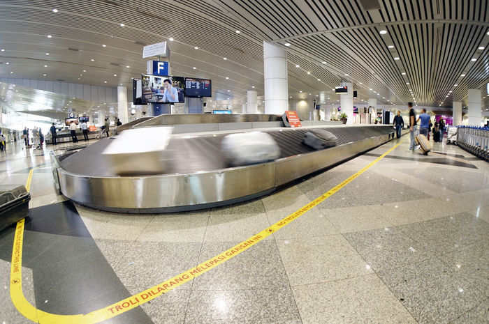 Baggage Island in the modern airport (luggage, airport, conveyor) with moving conveyor Airport Architecture Baggage Baggage Claim Built Structure Conveyor  Large Group Of People Lifestyles Mode Of Transport Person Transportation Travel Trolley