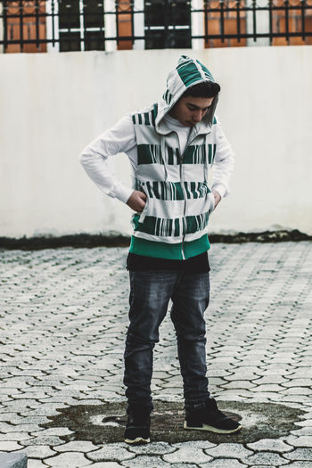 teen with hoodie looking down Fashion Looking Down Pensive Thinking Coldness Hoodie Shaft Style Teen Teenager Thoughtful Thoughts Tiles Fashion Stories