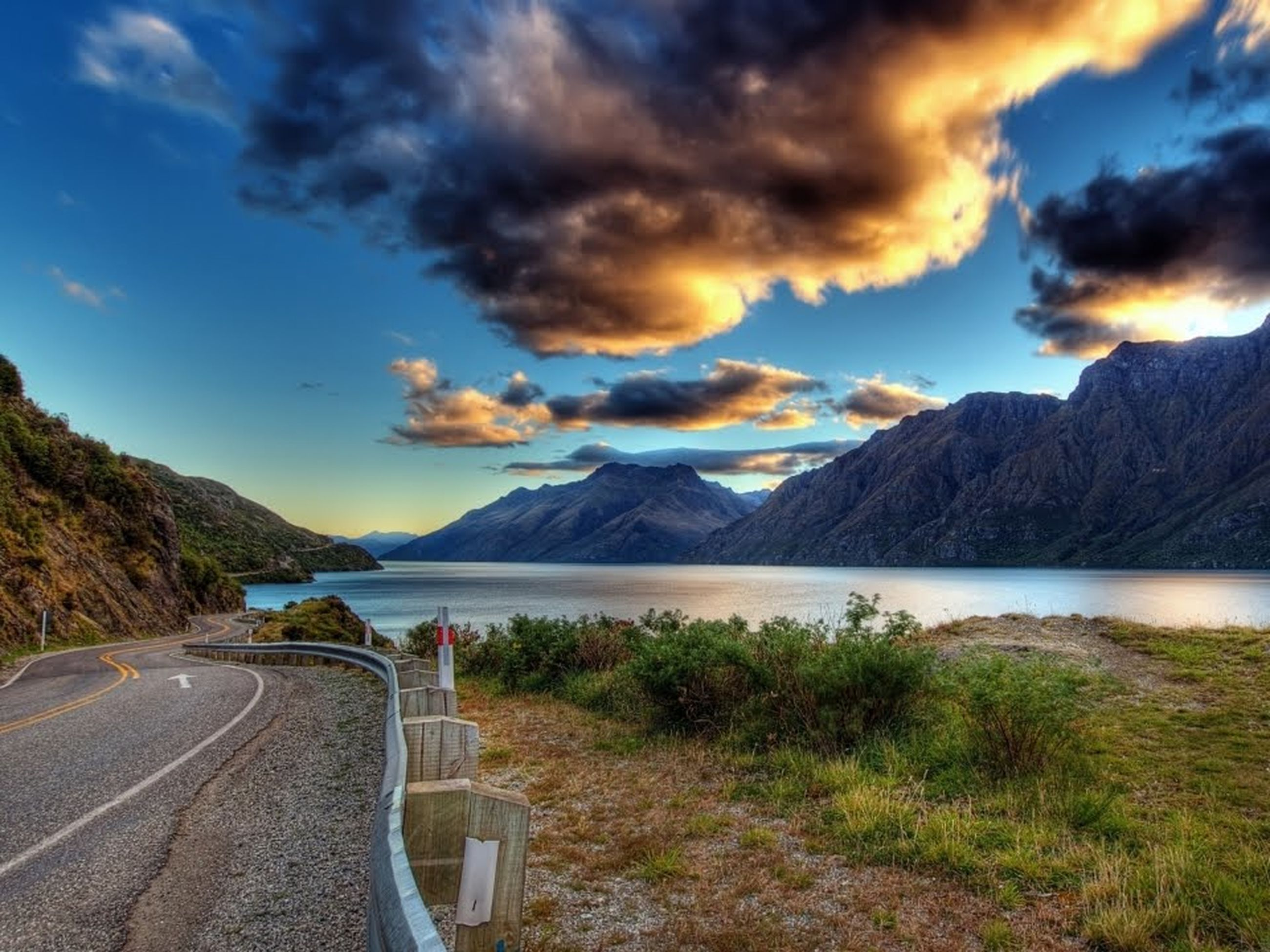 mountain, cloud - sky, sky, scenics, nature, beauty in nature, road, outdoors, mountain range, tranquility, landscape, no people, water, day