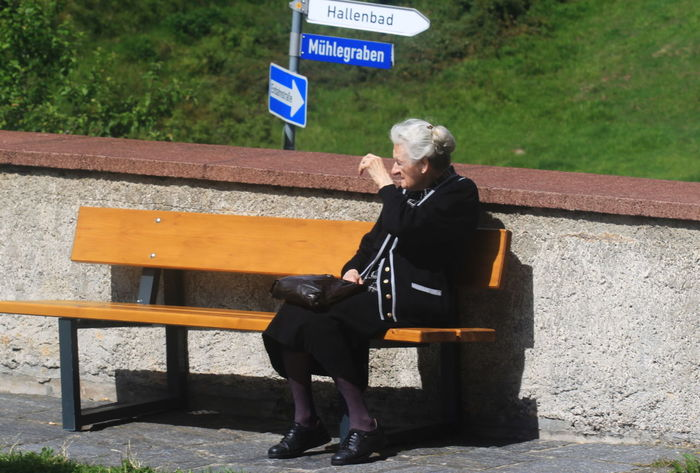 Schwarzwald Street Signs Summer 2013 Black Suit Day Full Length Germany Old Woman One Person Outdoors Real People Sitting On A Bench St Maergen Summer 2013
