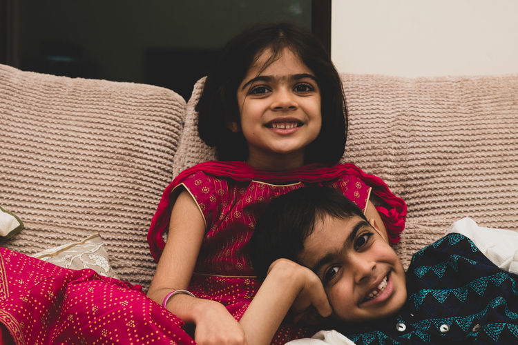 Portrait of brother and sister at home
