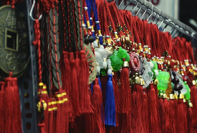 Close-up of chinese tassels hanging on display at market