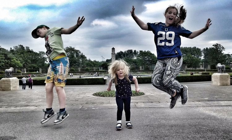 Full Length Day Togetherness Jumping Childhood Vitality People Outdoors Child Cloud - Sky Skill  Sky Adult Happiness Human Body Part Teamwork Young Adult