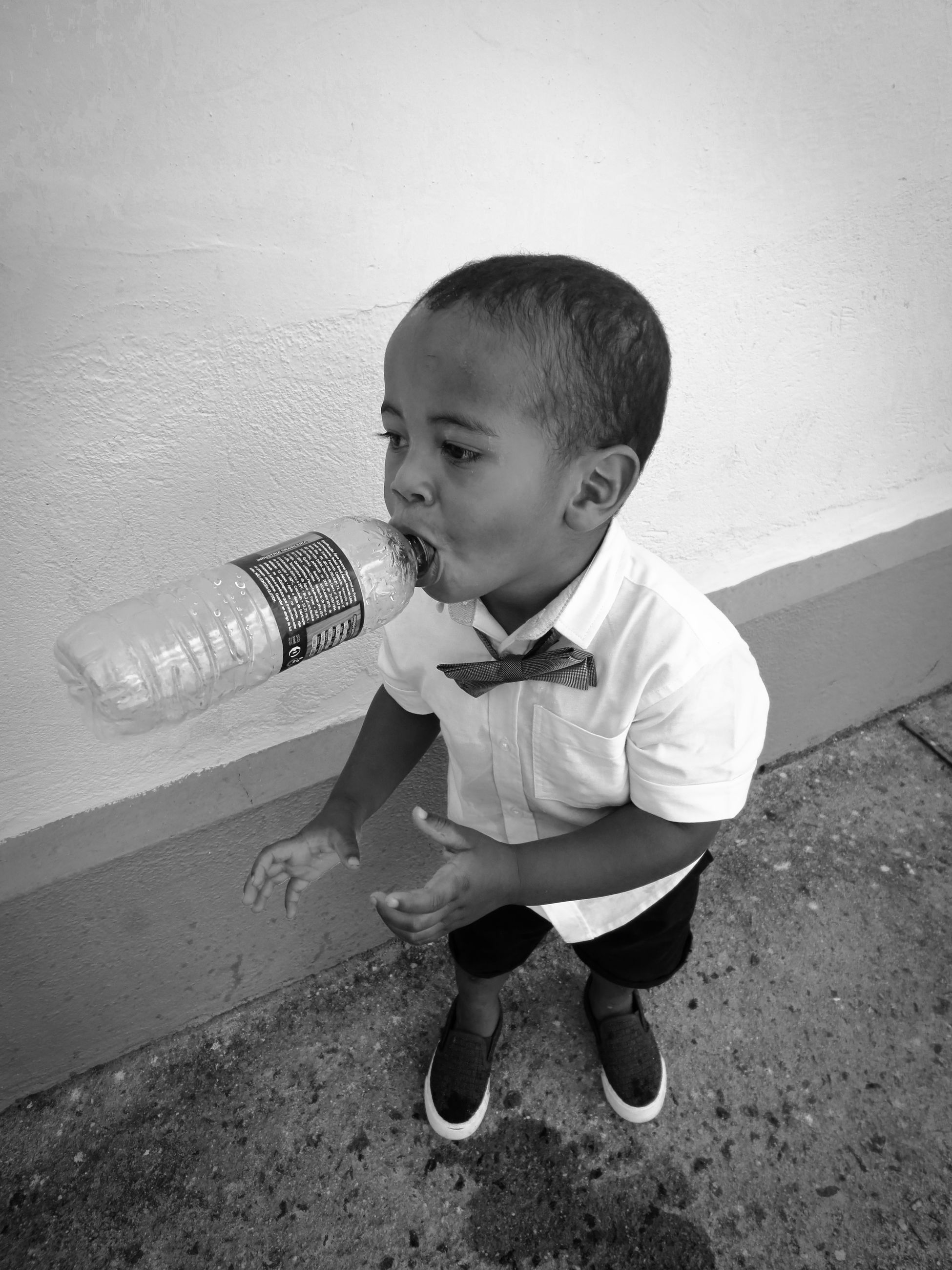 white, black, childhood, child, black and white, one person, monochrome, full length, monochrome photography, baby, men, toddler, cute, innocence, sitting, lifestyles, person, looking, casual clothing, bottle, day, standing, baby clothing