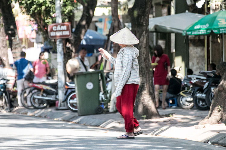 Vietnam Streetphotography Street Photography Woman Woman Portrait City Street Women Real People Road Hat Mode Of Transportation Incidental People Day Casual Clothing City Life Full Length Lifestyles Outdoors One Person Hanoi Adult Transportation Cityscape cityscapes