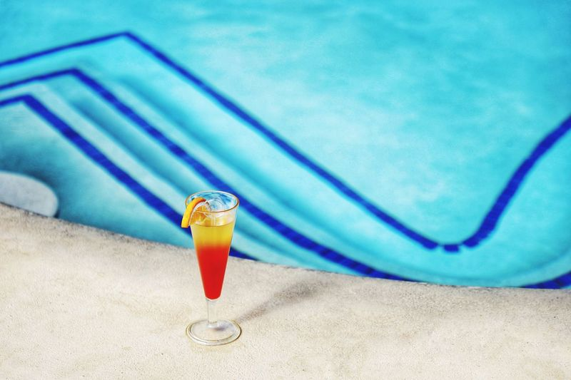 Having a Drink at the Pool Pool Cocktail No People Still Life Blue Close-up Focus On Foreground Indoors  Table Drink Water High Angle View Food And Drink Container Nature Refreshment Glass Day Absence Swimming Pool Beach Turquoise Colored Sand Land Summer Towel Sea Sky Selective Focus Beach Towel