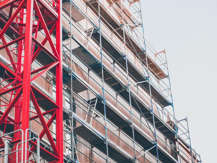 Crane next to building under construction