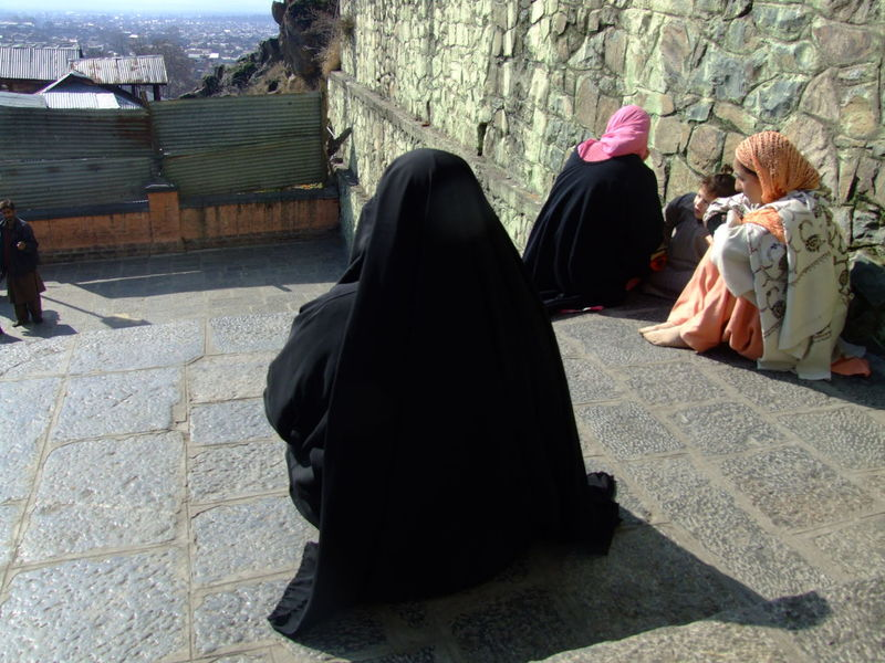 Women on the steps leading upto the shrine of Makhdoom Sahab in Srinagar. He is revered as the preeminent saint in the valley of Kashmir and people flock there to seek his intercession in addressing their problems and woes Outdoors Parers People Prayers Shrine Of Makhdoom Sahab Spiritual Place Srinagar Kashmir Stairs Traditional Clothing Women