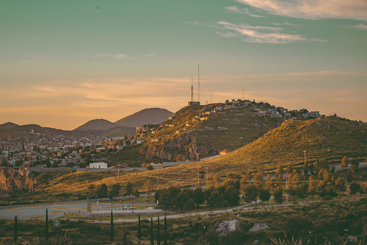 Panoramic shot of townscape against sky during sunset
