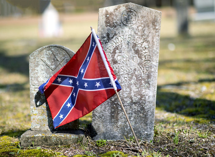 The battle flag of the Confederacy flies in front of the grave of Harmon B. Laster of the Mississippi 9th Infantry, Company C in the Shiloh Church cemetery in Shiloh, Tennessee. Flag Patriotism Day Solid Focus On Foreground No People Nature Outdoors Field Stone Material Close-up Plant Land Cemetery Rock Grass Tombstone Stone Grave Confederate Confederacy Csa Battle Flag Confederate Flag Civil War Civil War History Cemetery Shiloh Shiloh, Tennessee Veteran Photojournalism Gravestone Graveyard Battle Of Shiloh Springtime Harmon B. Laster Civil War Era Place Of Worship