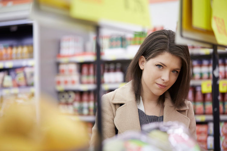 Portrait Of Beautiful Young Woman Standing In Store