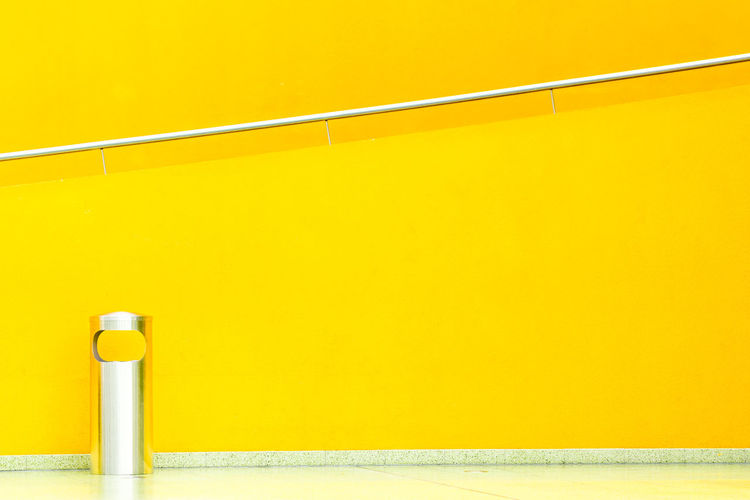 Railing on yellow wall