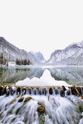 Cold Temperature Nature Snow Winter Beauty In Nature Tranquility Water Clear Sky Lake Mountain Scenics Tranquil Scene Day Outdoors No People Tree Sky Frozen Lake