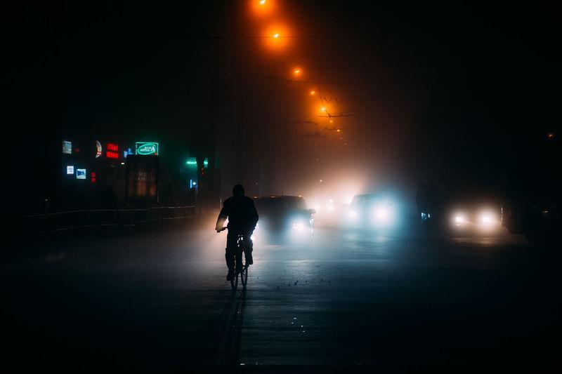 Full length of silhouette man on street at night