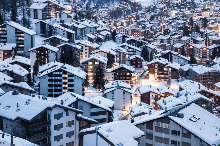 Snow covered houses in town during winter