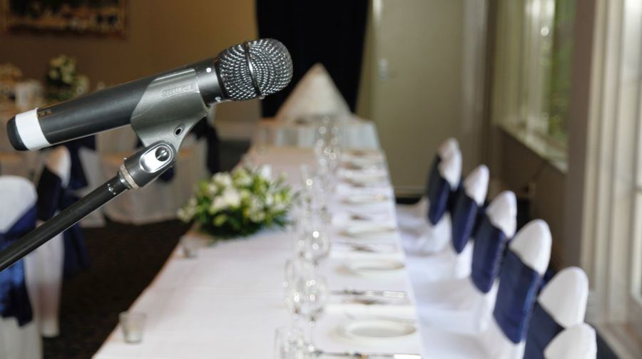 Close-Up Of Microphone At Dining Table