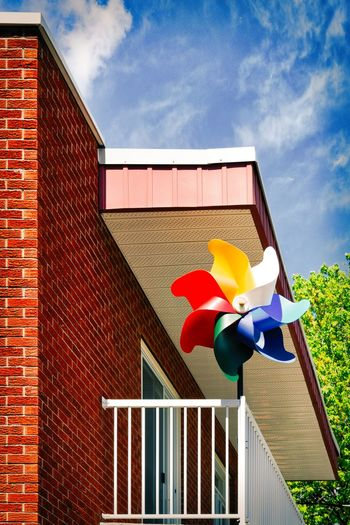 Built Structure Architecture Building Exterior Sky Cloud - Sky Nature Day No People Plant Red Brick Pinwheel Toy Brick Wall Building Outdoors Low Angle View Blue Representation Art And Craft Toy