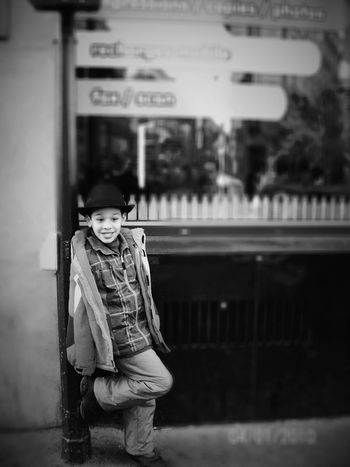 Kid Portrait Kid Photography Blackandwhite Photography Artphotography Fashion Photography EyeEm Selects Portrait Child Children Only Looking At Camera One Person Childhood People Smiling Standing Outdoors Arts Culture And Entertainment City Warm Clothing