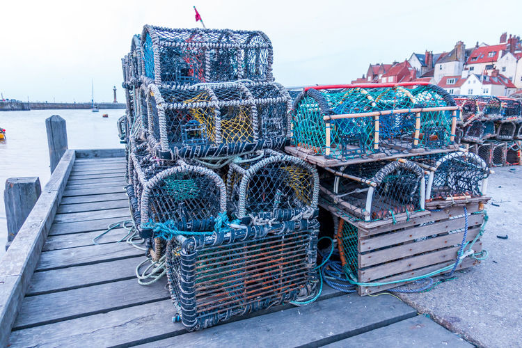 Whitby Whitby Harbour Whitby View Whitby North Yorkshire North Yorkshire North Yorkshire Coast Seaside Seaside Town Coastal Crab Pots Lobster Pots Lobster Traps Crab Traps Pier Sea Fishing Net Water Fishing Industry Fishing No People Outdoors Harbor Rope Day Sky