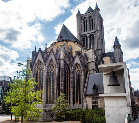 Ghent, Belgium Belgium Ghent Architecture Beauty In Nature Belief Building Building Exterior Built Structure City Cloud - Sky Day Gothic Style History Low Angle View Nature No People Outdoors Place Of Worship Religion Sky Spire  Spirituality The Past Travel Destinations
