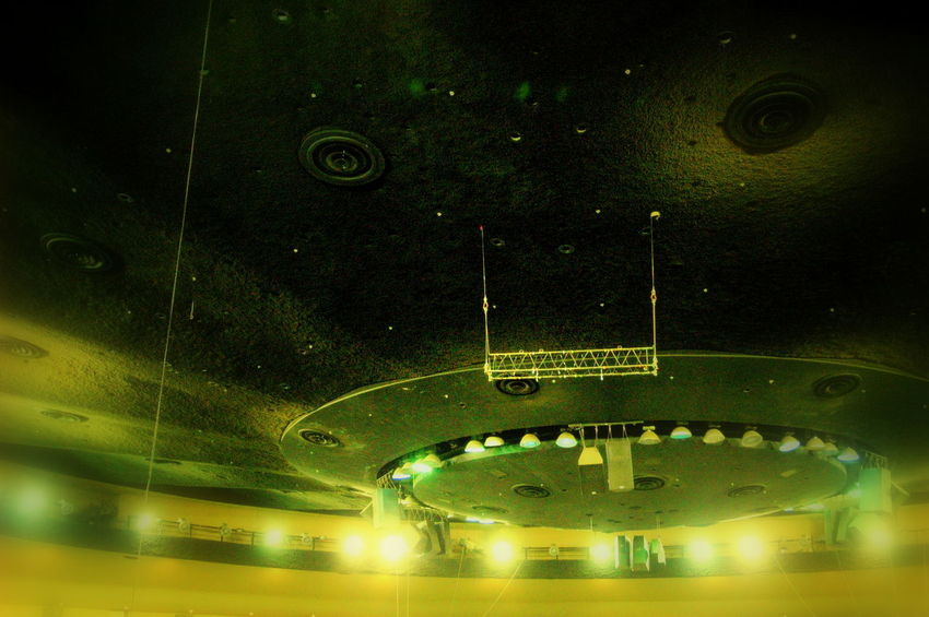 Top ceiling of a domed structure, at this angle looks similar to a UFO Flying Saucer Lights Top UFO UFO Sightings UFO? Above Close-up Flying Illuminated Indoors  Night No People Saucer Transportation Unidentified Up Up High Yellow Yellow Lights
