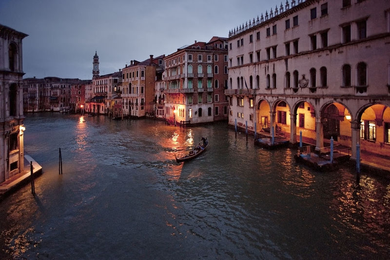 Grand canal amidst buildings against sky at dusk