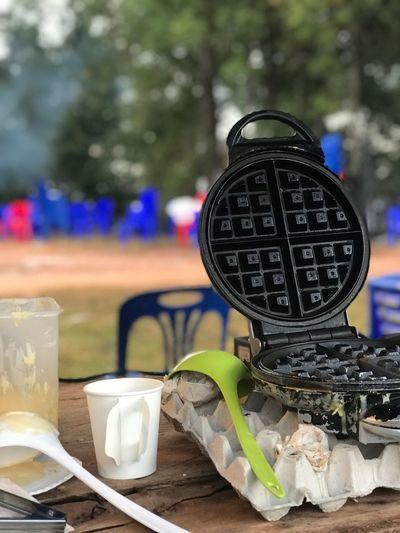 เตรียมทำวาฟเฟิลให้พี่น้องปกกากะญอ Waffle Time Table Text Focus On Foreground Day No People Outdoors Close-up