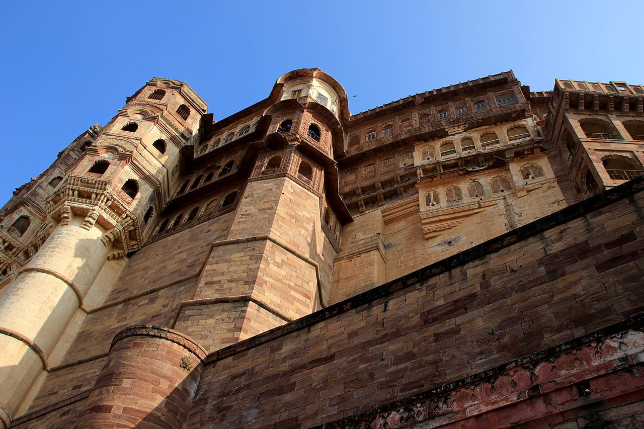 low angle view, architecture, built structure, building exterior, spirituality, religion, place of worship, church, history, tower, cathedral, clear sky, blue, old, travel destinations, tall, outdoors, historic, tall - high, day, sky, famous place, national landmark, ancient, tourism, no people, bell tower
