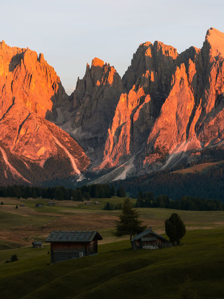 Sunset over Alpe Di Suisi, Italy. Such a beautiful place. Week On Eyeem Alpe Di Siusi Dolomites, Italy Domestic Animals Mountain Environment Italy Travel Destinations Sky Olympus Em1 Mk2 Outdoors Mountain Peak Mountain Range Beauty In Nature Nature Landscape Remote Hut Scenics - Nature Tranquil Scene No People Idyllic Plant Field Autumn Mood
