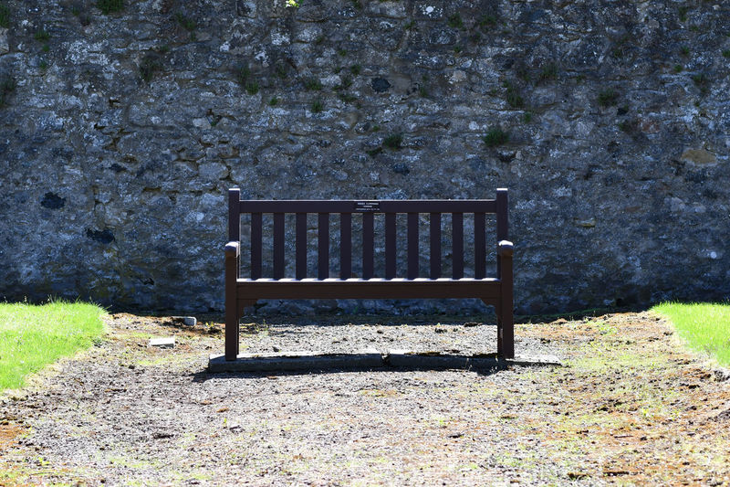 Empty Seat Land Bench Day Field No People Wood - Material Absence Grass Park Tranquility Outdoors Park - Man Made Space Relaxation Beauty In Nature Growth Park Bench Stone Wall Lonely Peace Benches_Of_The_World_Unite