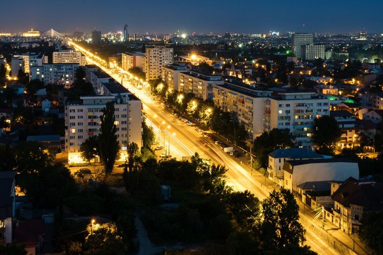 Night Illuminated Street Road High Angle View City Street Outdoors Cityscape City Light Trail Aerial View Landscape Sky Vacations No People Architecture Sunset Building Exterior Tree Nature The Great Outdoors - 2017 EyeEm Awards Skyscraper Mode Of Transport Bucharest Travel Destinations