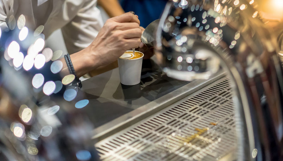 how to make latte art by barista focus in milk and coffee in restaurant Adult Close-up Coffee - Drink Coffee Cup Day Drink Food And Drink Freshness Human Body Part Human Hand Indoors  Midsection Occupation One Person People Preparation  Real People Refreshment Technology Women Working