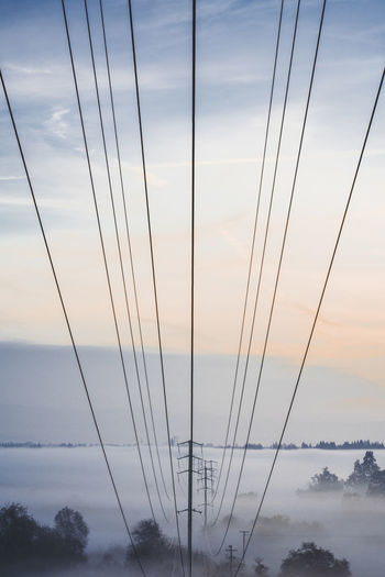 Beauty In Nature Cable Cloud - Sky Connection Day Dusk Electricity  Electricity Pylon Fuel And Power Generation Low Angle View Nature No People Outdoors Power Line  Power Supply Scenics - Nature Sky Sunset Technology Tranquil Scene