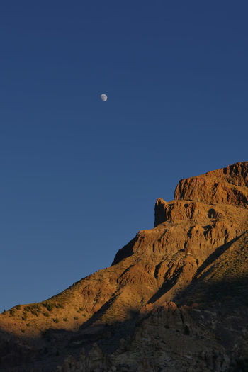 rising moon over red rocks in Tenerife, Spain Moon Tranquility Beauty In Nature Rock Formation Nature Idyllic Mountain Scenics - Nature Scenery Landscape Dark Sky Light And Shadow Red Environment Hiking Adventure Discover  Explore Lonely