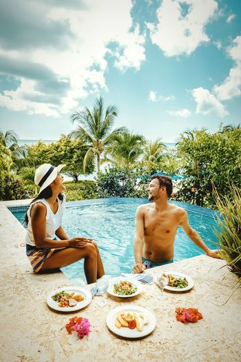 Couple Couple Travelling Travel Couple St Lucia Saint Lucia Man Colourful Beach Boy Lunch Dinner Pool Infinity Pool Infinity Swimming Pool Swim Pool Friendship Men Togetherness Shirtless Sitting Happiness Tree Beach Summer Fun Swimming Lane Marker Pool Party Lounge Chair Swimming Goggles Deck Chair