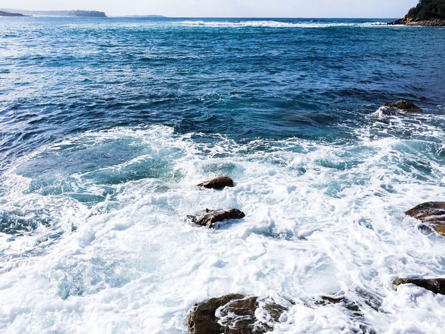 Waves by the seashore Sea Nature Water Beauty In Nature Horizon Over Water Tranquil Scene Wave Beach Ocean Motion Crashing Power In Nature Scenics Rock - Object Surf Sky Outdoors