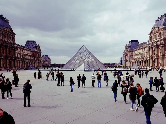 Musée du Louvre Travel Destinations Outdoors Architecture Vacations Day Large Group Of People City Sky Cityscape People Ice Rink Adults Only Adult First Eyeem Photo